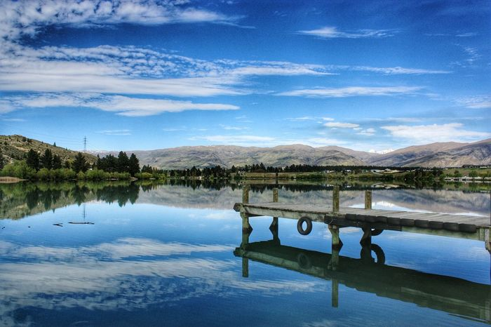 Life is only a reflection of what we allow ourselves to see.. Old Cromwell, New Zealand Reflection Water Lake Sky Blue Outdoors Beauty In Nature Mountains And Sky Mountains On The Lake Lake View Jetty Jetty View Wharf Wharfside Nzscenery NZ South Island New Zealand Scenery New Zealand New Zealand Photography New Zealand Impressions New Zealand Landscapes NZ NZ :) Landscape_Collection