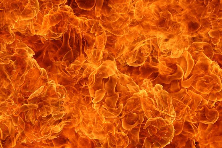 Full frame shot of fire crackers against black background