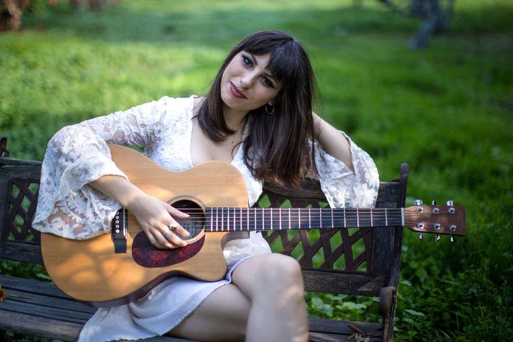 Another picture of Katie Ferrara . KatieFerrara DTLA Singer-songwriter Singersongwriter Losangeles Hollywood Guitarist Guitar Green Grass