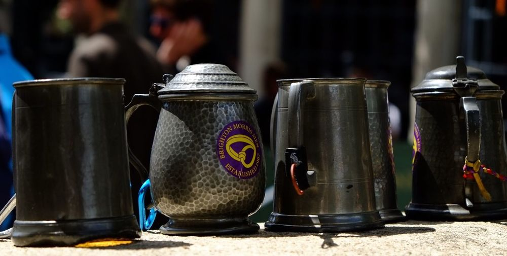 Morris dancers pewter tankards lined up. Focus On Foreground No People Fujifilm_xseries Outdoors Morris Dancers Tankards Pewter Brighton