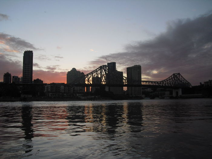Australia series: Brisbane... City City View  Cityscape Bridge Architecture Sunset Sunset Silhouettes Dusk Dusk In The City River Riverside Water_collection Water Reflections Reflections Outdoors Travel Memories Brisbane River Skyscrapers Sky Skyline Tranquil Scene in Brisbane Queensland Australia