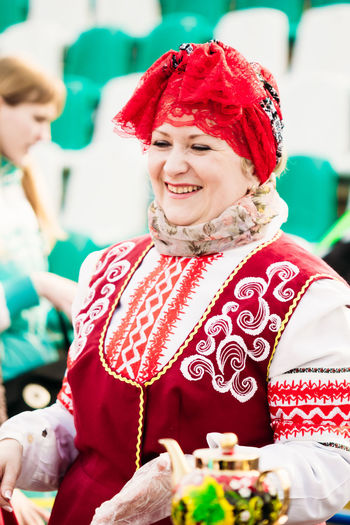 Gomel, Belarus - March 12, 2016: Cheerful woman in the Belarusian national clothes on holiday Maslenitsa Shrovetide Belarus Celebration Gomel Holiday Tradition Woman Celebration Costume Culture Day Decoration Editorial  Entertainment Ethnic Famele Folk Headscarf Lifestyles Maslenitsa National Costume Real People Red Shrovetide Traditional Traditional Clothing