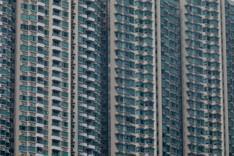 Loneliness Apartment Architecture Backgrounds Building Building Exterior Built Structure City Day Full Frame Highrise In A Row Low Angle View No People Outdoors Pattern Repetition Residential District Skyscraper Tall - High Window