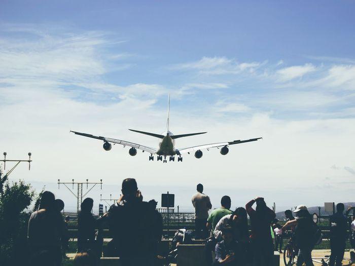 People watching airplane