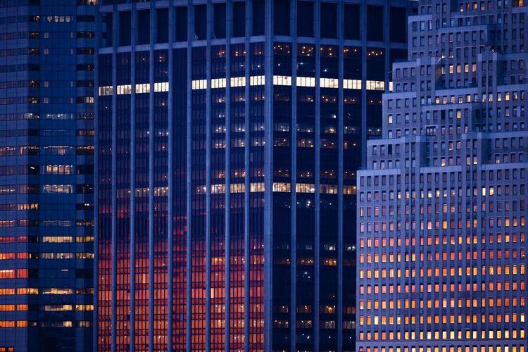 Digital composite image of modern building at night