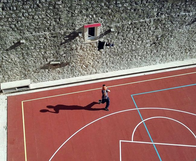 High Angle View Of Man Playing Basketball