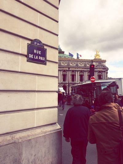 Rue De La Paix - Paris Architecture Built Structure Building Exterior Text Real People Cloud - Sky Outdoors Day Sky Communication City Men Women People