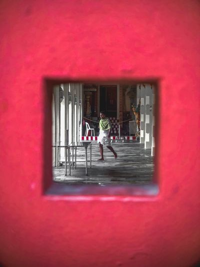 Temple in Singapore Chinatown Man Street Photography IPhone ASIA Oowa IPhone Singapore Architecture Window Built Structure Red Pink Color Building City Day The Street Photographer - 2018 EyeEm Awards The Traveler - 2018 EyeEm Awards EyeEmNewHere