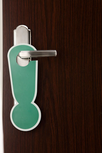 Close-up of exclamation sign on doorknob
