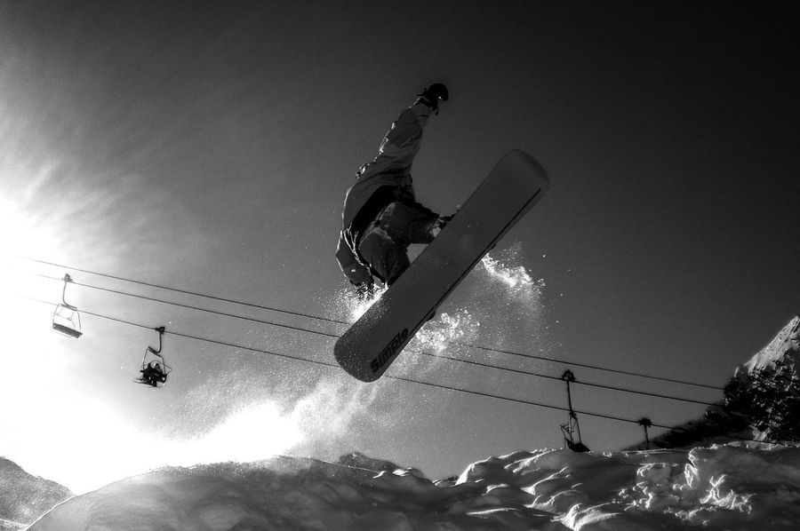'High Fly''. . . Snowboarding Blackandwhite Photography Action Shot  Snowscape Lightandshadow Ski Lift Car Cables Freezing Energy Extreme Sports
