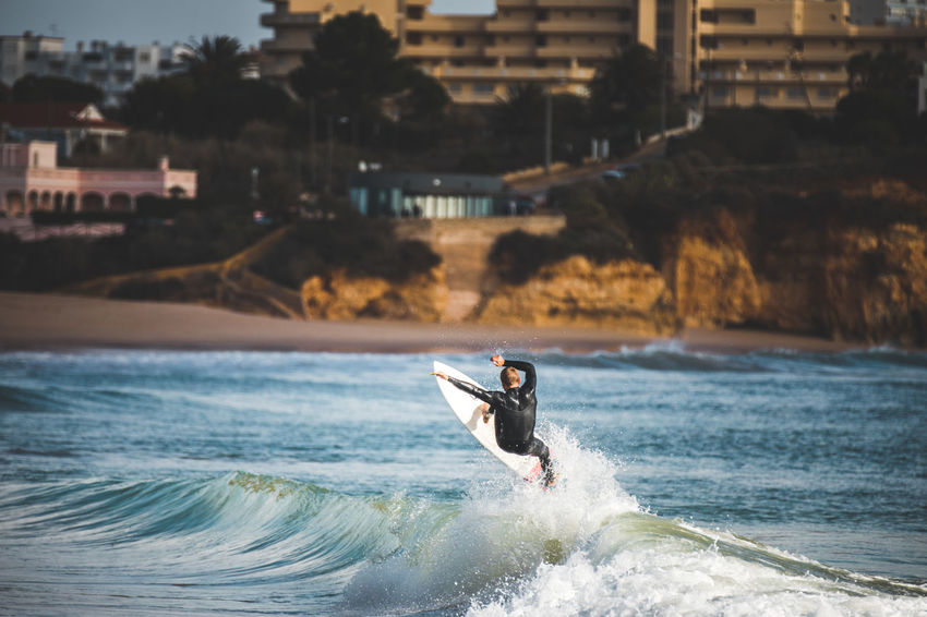 The city background though :) Algarve Portugal Wave Adventure Extreme Sports Lifestyles Men Motion Nature One Person Outdoors People Real People Sea Surface Level Surfing Water Waterfront Wave An Eye For Travel Go Higher