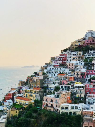 Colorful houses from Positano, Italy Italy Colorful Summer Time  Summer Travel Photography Traveling Traveler Sea Sun  Holiday Positano Positano, Italy Building Exterior Sea Sky Architecture Water Built Structure City Residential District Building Nature Beach Horizon Over Water Horizon No People Land House Sunset Outdoors Cityscape
