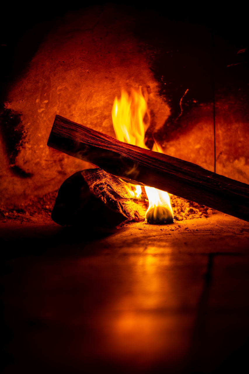 burning, flame, fire, fire - natural phenomenon, heat - temperature, orange color, glowing, nature, motion, wood - material, night, no people, sign, wood, warning sign, log, blurred motion, environment, indoors, firewood, bonfire