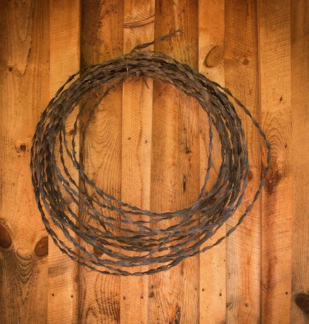 EyeEm Selects Brown Close-up No People Indoors  Concentric Day Barbed Wire Rustic Wood Wall Coiled Coiled Wire