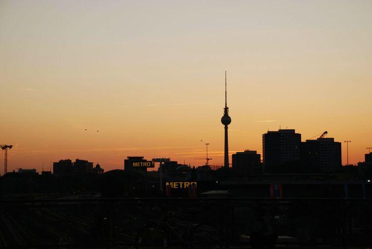 Sunset Sun TV Tower Railroad Station Railway Train Nature Architecture City Built Structure Sunset Sky Tower Building Exterior Travel Destinations Tall - High Cityscape Building City Life Travel Spire  Silhouette Television Industry Nature No People Office Building Exterior Skyscraper