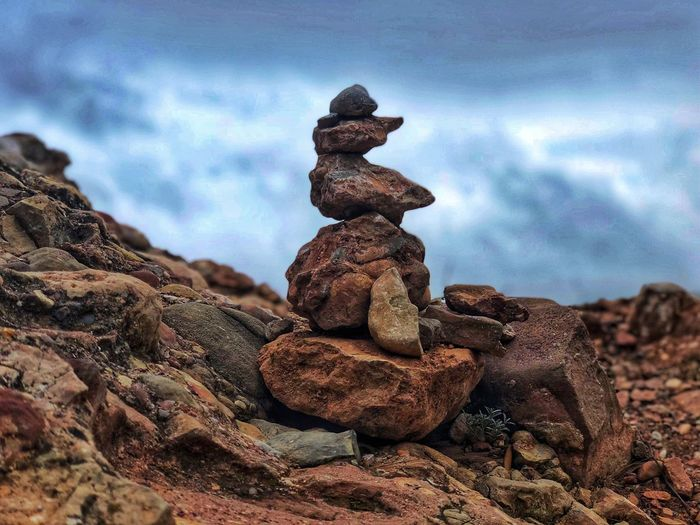 A pyramid of red balancing stones against the background of dark storm clouds. Rock balancing Scenics Rock Balancing Red Stone Red Rock Storm Cloud Cloudy Cloud - Sky Balance Rock Stack Solid Sky Rock - Object Stone - Object Day Nature Land Zen-like No People Outdoors Tranquility Stone My Best Photo My Best Photo