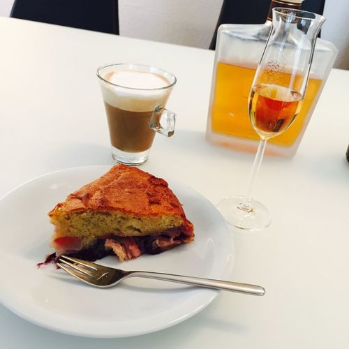 Close-Up Of Serving Sweet Pie With Coffee And Wine