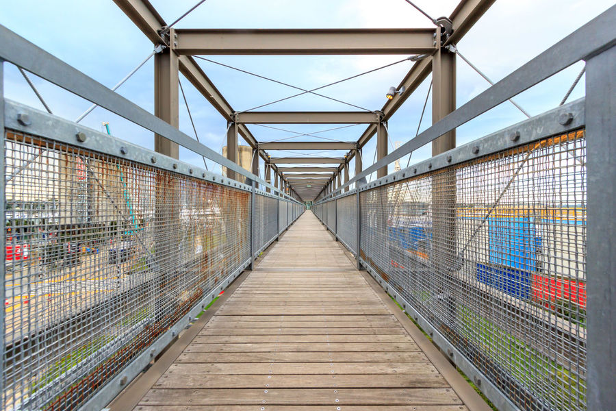 Neverending bridge Architecture Bridge Bridge - Man Made Structure Built Structure Connection Day Diminishing Perspective Direction Empty Footbridge Footpath Long Metal Nature No People Outdoors Railing Sky The Way Forward Transportation vanishing point
