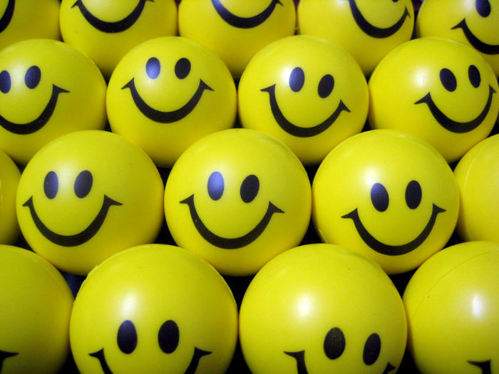 Full frame shot of yellow anthropomorphic smiley balls