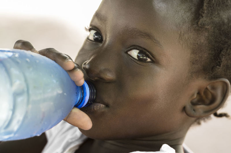 Close-up portrait of boy drinking water