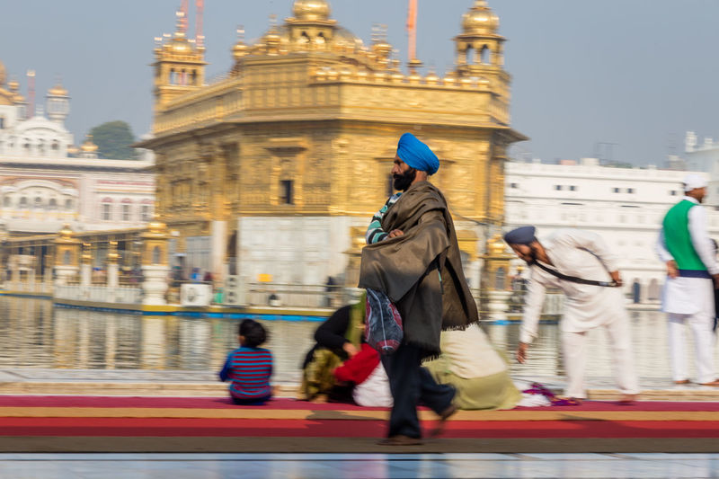 Walking sikh man in front of the Golden Temple, Amritsar, India Amritsar Architecture Architecture Blurred Motion Defocused Golden Golden Temple Headwear India Indian Motion One Person Sikh Sikh Temple Sikhism Speed Temple Tourism Traditional Clothing Travel Destinations Turban Worship