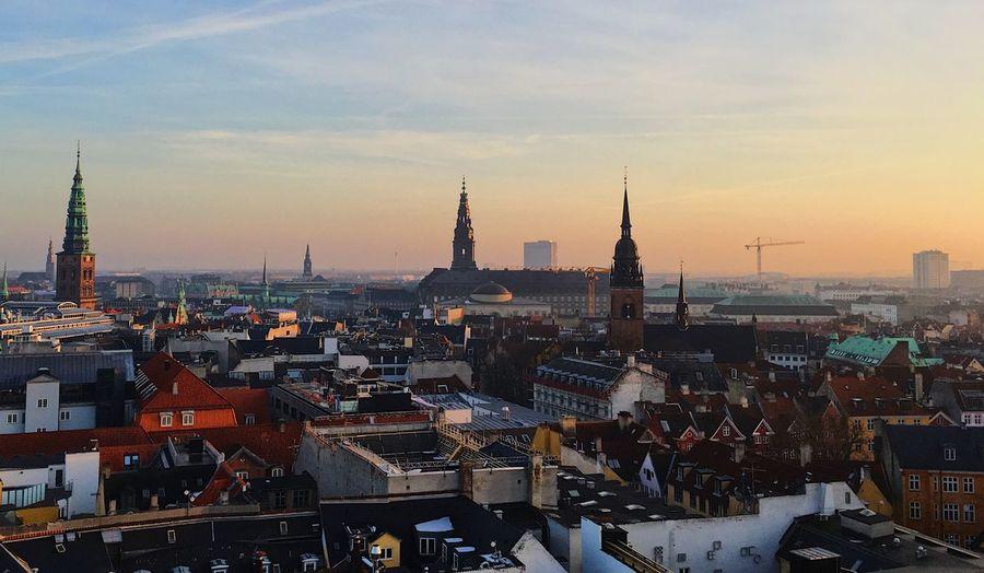 View of copenhagen cityscape against sky