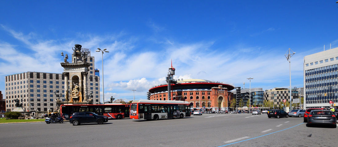 Barcelona's urban scene with public transportation Barcelona Architecture Building Exterior Built Structure Car City Cloud - Sky Government Mode Of Transportation Motor Vehicle Nature Outdoors Sky Traffic Transportation Travel Travel Destinations