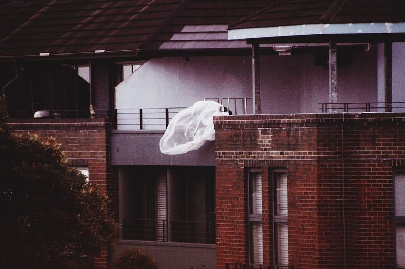 Clothes drying on roof against building