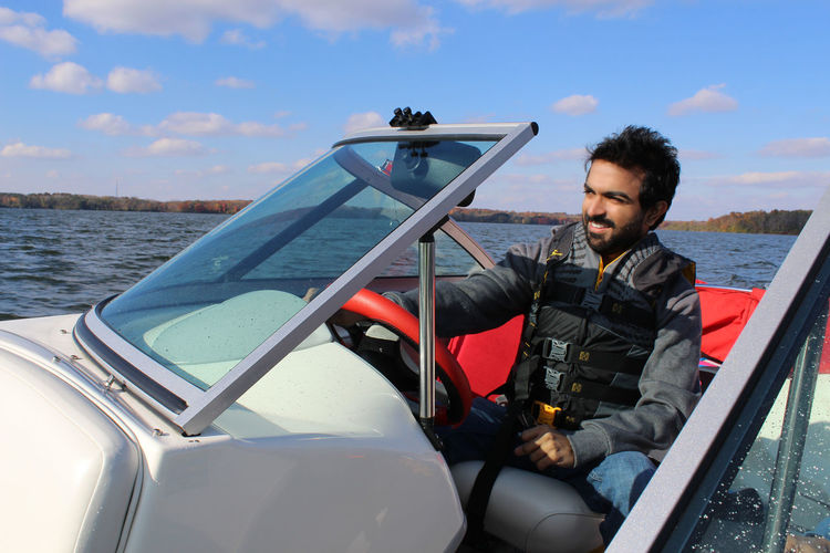 Boat Boating Lake Water Leisure Activity Water Sports Motorboat Ohio, USA Ocean Young Adult East Indian American Dream Life Jacket Driving Boat Transportation Mode Of Transportation Sitting Real People One Person Men Sea Young Men Nature Outdoors Lifestyles