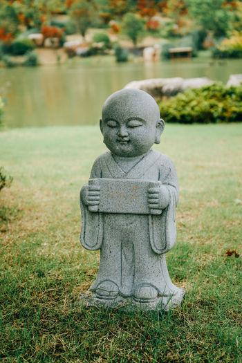 Statue on field in park