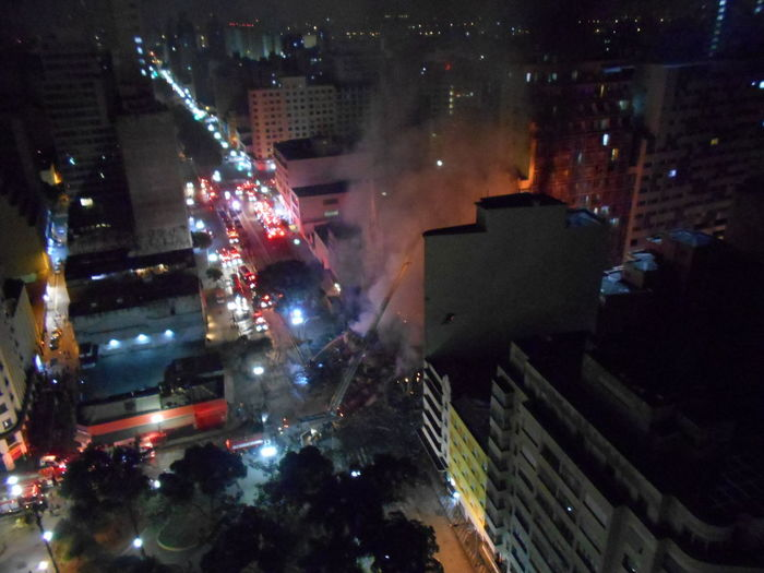 Building Collapse: Inner City Calamity in downtown São Paulo at Largo do Paissandú; 3 am May 1, 2018. The abandoned former Federal Police steel and glass skyscraper, which had been invaded by street people, imploded this early morning and the neighboring building has caught on fire as well. This photo taken between 4 am to 5 am, May 1, 2018 at Largo do Paissandú. Current Events Destruction Largo Do Paissandu May 1, 2018 Night Photography Susan A. Case Sabir The Week on EyeEm Unretouched Photography About 4 Am Building Collapse Building Fire Building Implosion Burning Building Controlled Chaos Dangerous Situation Downtown São Paulo Firefighters In Action Helicopters Overhead High Angle View Implosion Responsiveness Smoke - Physical Structure Unexpected Event Urban Photography Urban Strife