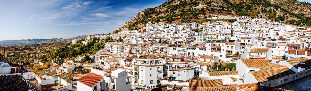 Panoramic view of white village of mijas by mountains
