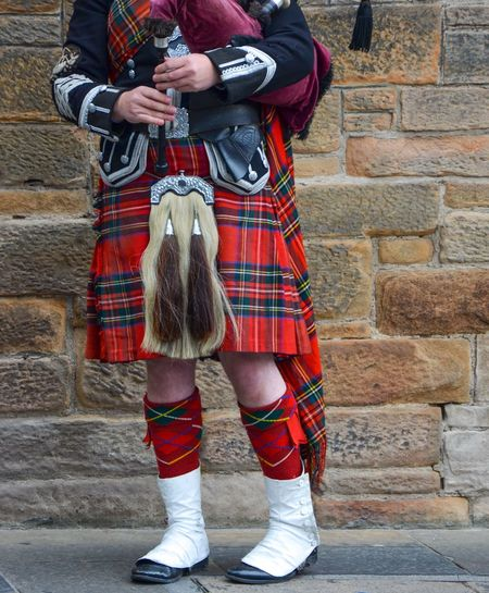 Totally Scottish Musician Man Tradition Bagpipes Scottish Scot Standing Kilt Brick Wall Brick Wall Clothing Plaid Low Section One Person Day Adult Red Human Body Part Shoe Outdoors Wall - Building Feature