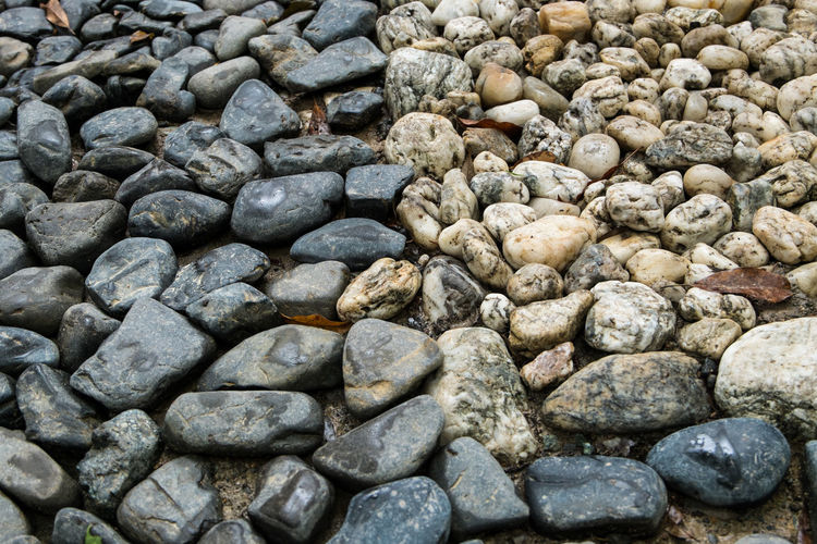 The line between sacred and profane. Stones marking the sacred area of a shrine at Naiku, Ise Ise Japan Naiku Pebble Profane Sacred Shinto Shrine Stone - Object