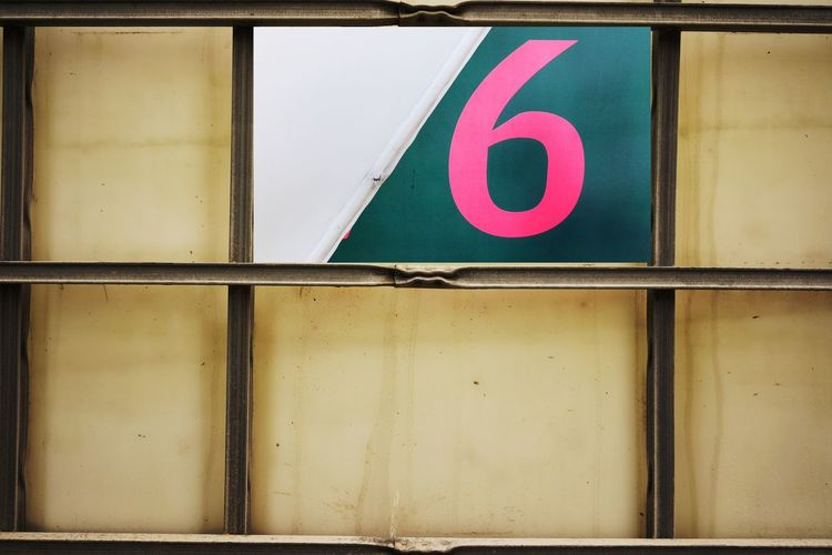 Close-up of number 6 on window