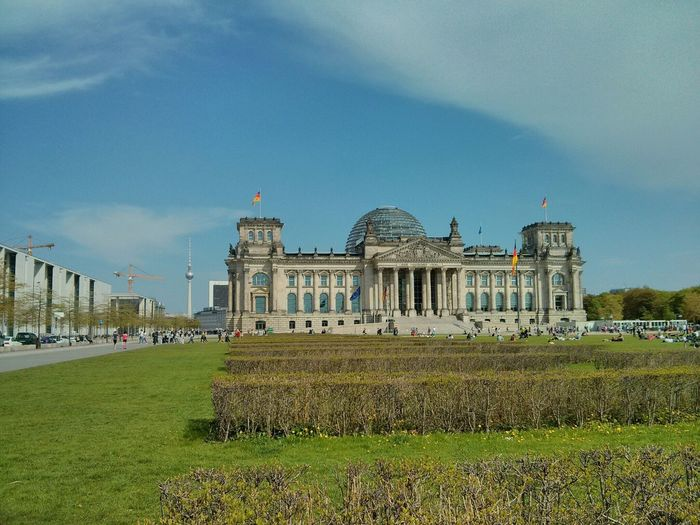 Facade of historic reichstag building against sky