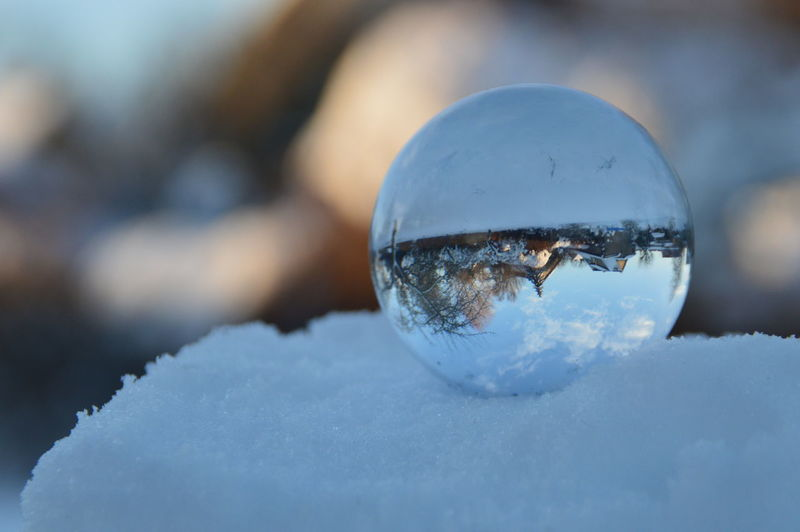 Close-up of crystal ball in winter