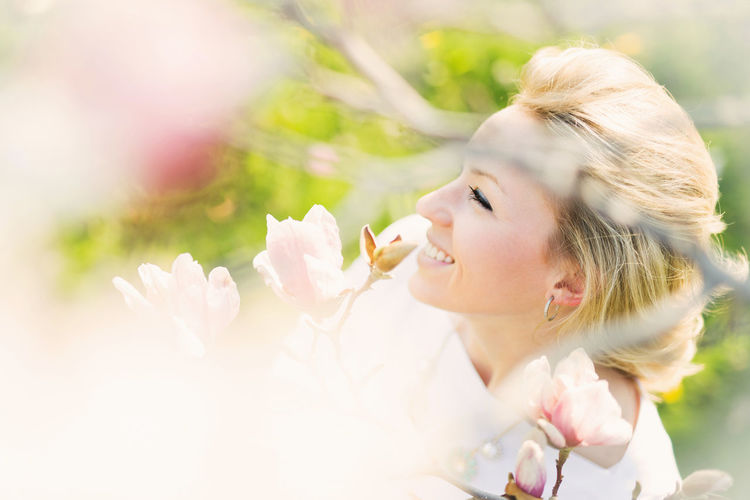 Enjoying a beautiful spring day! Flower One Person Flowering Plant Young Women Young Adult Plant Women Lifestyles Beauty Leisure Activity Beautiful Woman Blond Hair Hair Headshot Real People Fragility Selective Focus Nature Adult Hairstyle Outdoors Flower Head Magnolia Tree Magnolia Flower