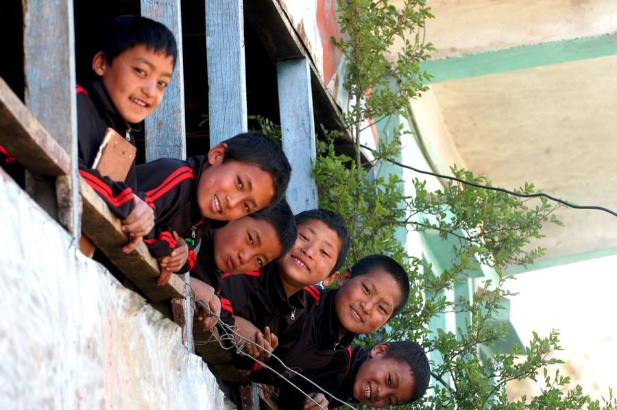 """Smiling Buddhas Smiling kids in a government school in Hile, Nepal. They seem so blessed and rightly named """" Smiling Buddha's """" by a friend of mine while on our way back from our trek to Chowki, a little below Gupha Pokhari, Nepal. #Friendship #children #friends #government School #nepal #play #schoole Bonding Boys Childhood Group Of People Happiness Leisure Activity Outdoors Portrait Positive Emotion Real People Smiling Son Togetherness"""