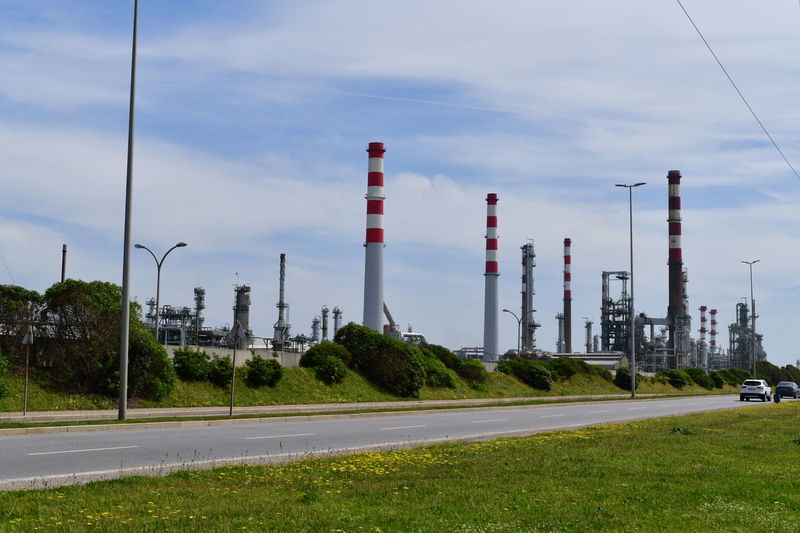 Industry Sky Factory Fuel And Power Generation Building Exterior Smoke Stack Nature Plant Day Cloud - Sky Road Architecture No People Built Structure Technology Industrial Building  Transportation Outdoors Grass Power Station Electricity  Pollution Cooling Tower Air Pollution Power Supply