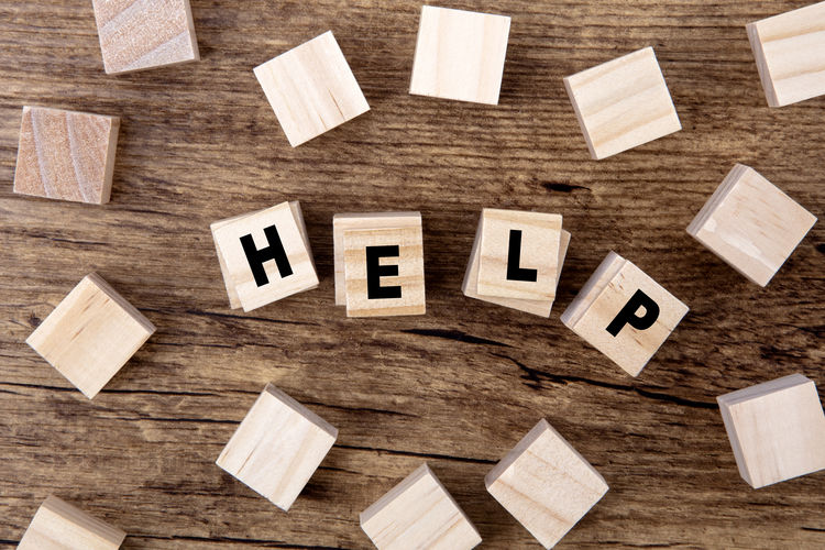 Directly above shot of help text on wooden blocks
