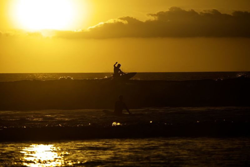 Sunset Water Sky Silhouette Nature Scenics - Nature Beauty In Nature Sea Orange Color Sunlight One Person Sun Standing Waterfront Reflection Leisure Activity Outdoors Horizon