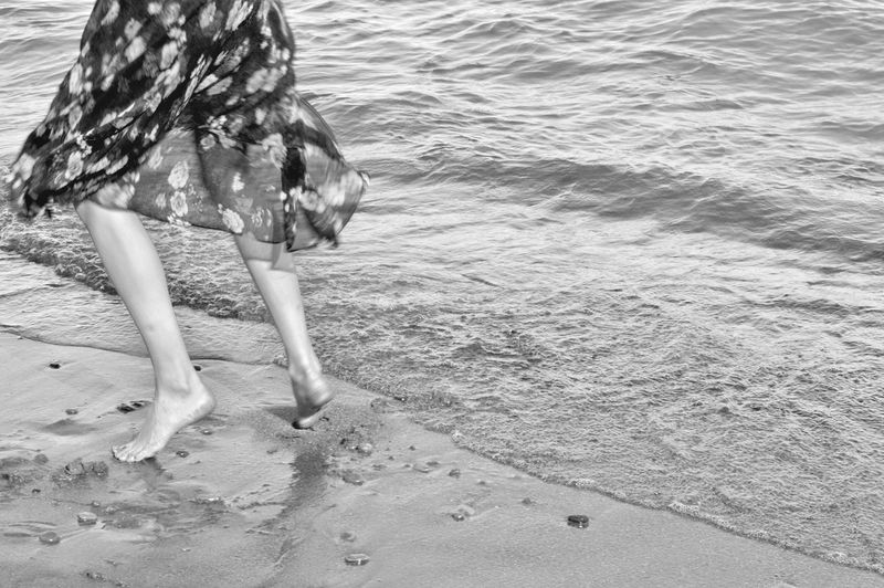 Cold, cold, cold!. With the permission of @juliaharris. Beach Sand Sea Water One Person Low Section People Beauty In Nature Outdoors Nature Whitby Ontario Canada Nature Photography EyeEm Meet Up 2017. Linde Shores Conservation Area Whitby. EyeEm Best Shots Black And White. Black And White Photography . Breathing Space