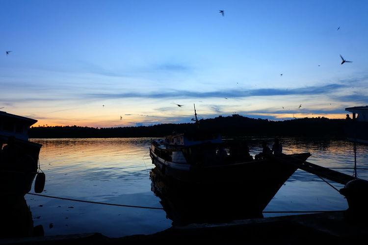 EyeEmNewHere Beauty In Nature Bird Cloud - Sky Fishing Boat Fujifilm Lake Marina Mindanao Moored Nature Nautical Vessel Outdoors Reflection Sailboat Scenics - Nature Silhouette Sky Sunset Sunsets Tawi-tawi Tranquil Scene Tranquility Transportation Water