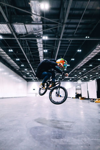 SNAEKERCON Colors EyeEm EyeEm Best Shots Light London Activity Architecture Bicycle Bmx  Built Structure Full Length Illuminated Indoors  Lifestyles Mid-air Motion One Person Real People Skill  Space Sport Streetphotography Stunt