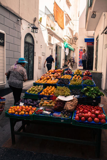 Capri, Italy, a fruit stall along the narrow streets of the island. Abundance Capri Cityscapes Display Food For Sale Freshness Fruit Fruit Stall Healthy Eating Holiday Italy Market Market Market Stall Selling Shop Small Business Store Streetlife TOWNSCAPE Traveling Variation