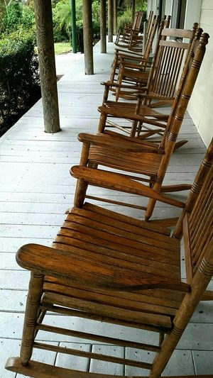 rock 'n row Rocking Chair In A Row Veranda Rocking Chairs Have A Seat Group Of Objects Wooden Chair Wood - Material Chair Empty Furniture Absence No People Relaxation Seat Outdoors