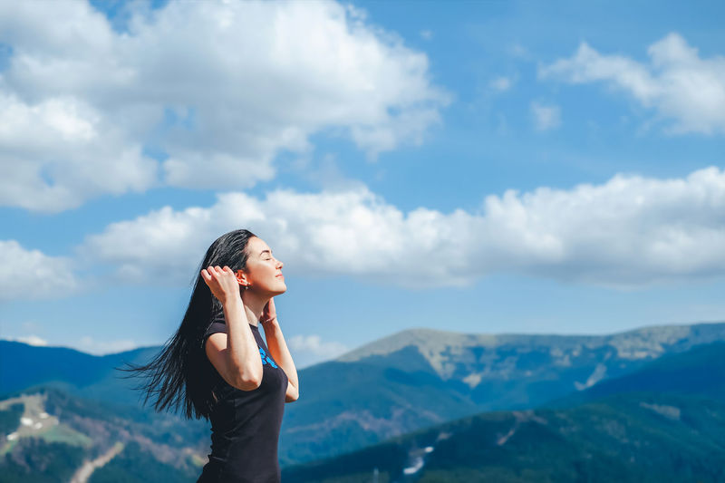Sky Cloud - Sky One Person Beauty In Nature Lifestyles Leisure Activity Real People Young Adult Scenics - Nature Mountain Young Women Mountain Range Non-urban Scene Nature Tranquil Scene Standing Tranquility Idyllic Adult Outdoors Beautiful Woman Hairstyle