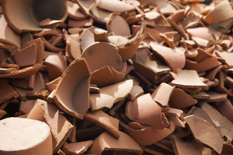 Full Frame Shot Of Broken Pottery Pots
