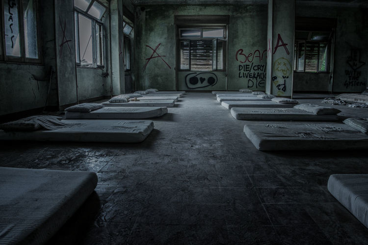 Mattresses arranged in abandoned building